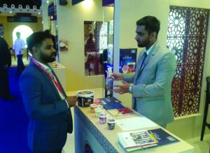taste cake pieces at Gulf Food Exhibition
