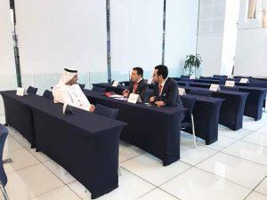 participants explaining business concept to visitor