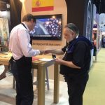chef talking with visitor at spain venue zone